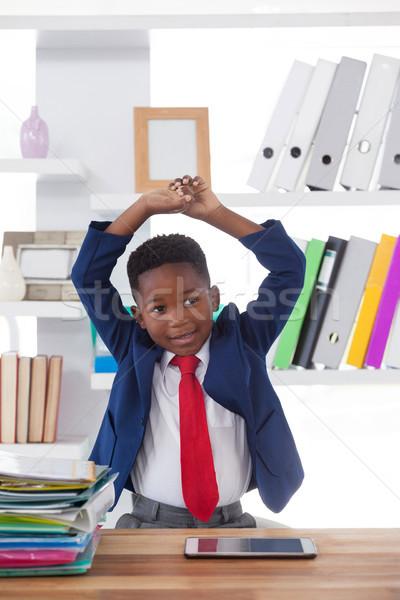 Boy imitating as businessman stretching while looking away Stock photo © wavebreak_media