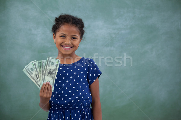 Portrait of girl showing paper currency Stock photo © wavebreak_media
