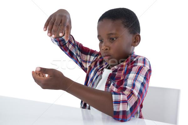 Fiú munka láthatatlan tárgy fehér gyermek Stock fotó © wavebreak_media