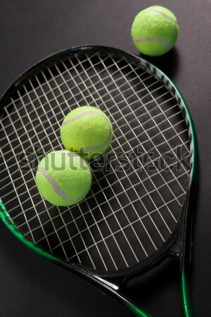 Close up of fluorescent yellow tennis racket and ball Stock photo © wavebreak_media