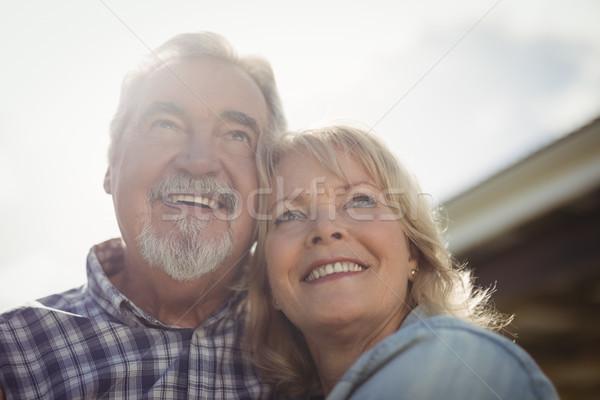 Smiling senior couple standing together in garden Stock photo © wavebreak_media