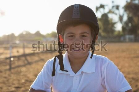 Boy feeding the horse in the ranch Stock photo © wavebreak_media