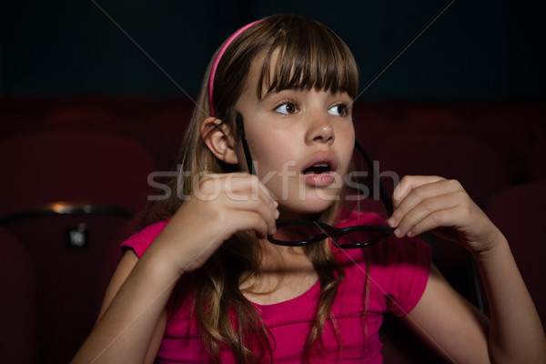 Girl wearing 3D glasses while watching movie in theater Stock photo © wavebreak_media