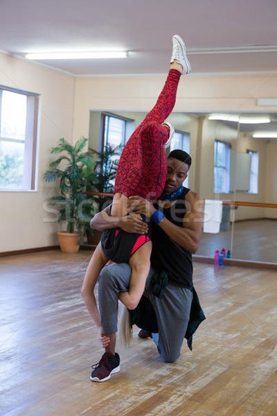 Dancers rehearsing on floor at studio Stock photo © wavebreak_media