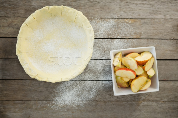 Overhead view of pastry dough and apple slices in container Stock photo © wavebreak_media