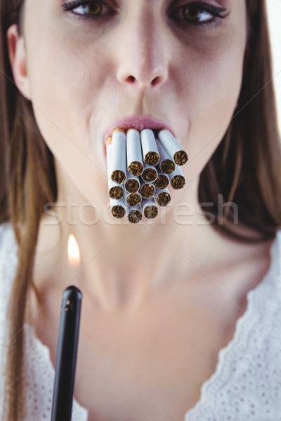 Vrouw verlichting veel sigaretten mond witte Stockfoto © wavebreak_media