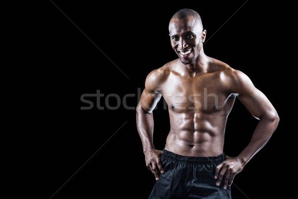 Portrait of happy muscular man with hand on hip Stock photo © wavebreak_media