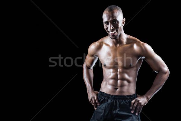 Portré boldog izmos férfi kéz csípő Stock fotó © wavebreak_media