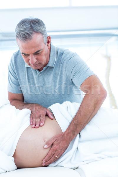 Masseur giving massage to pregant woman Stock photo © wavebreak_media