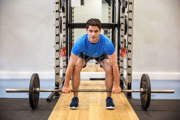 Focused man about to lift a barbell Stock photo © wavebreak_media