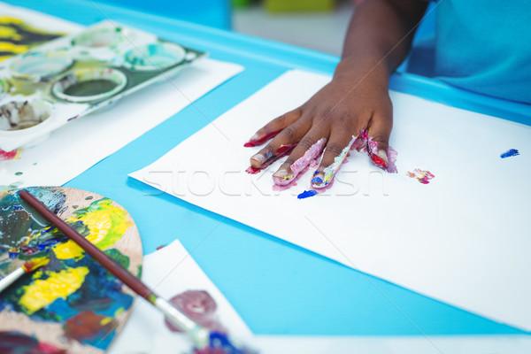 Happy kid enjoying painting with his hands Stock photo © wavebreak_media