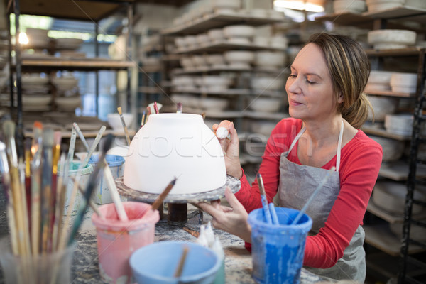 Female potter decorating bowl Stock photo © wavebreak_media