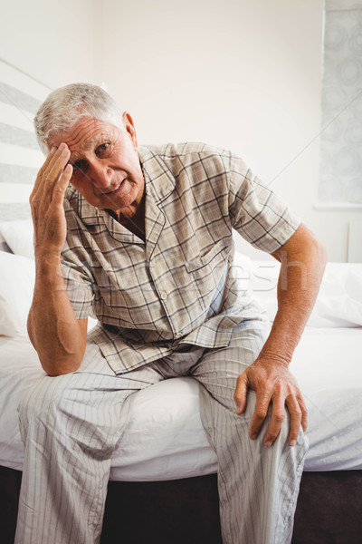 Frustrated senior man sitting on bed Stock photo © wavebreak_media