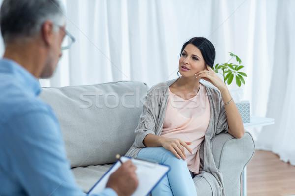 Mulher grávida falante médico casa casa caneta Foto stock © wavebreak_media