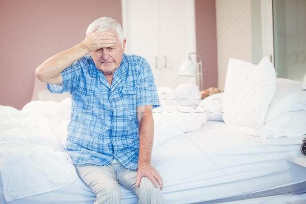 Suffering senior man holding his head st home Stock photo © wavebreak_media