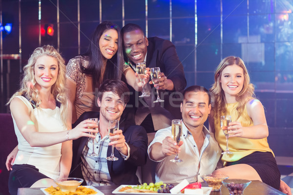 Friends with champagne and snacks Stock photo © wavebreak_media