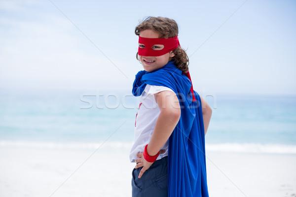 Boy in superhero costume standing with hand on hip Stock photo © wavebreak_media
