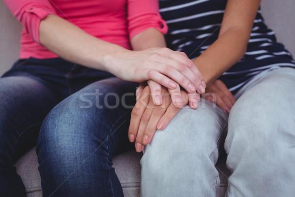 Mulher reconfortante amigo casa sala de estar Foto stock © wavebreak_media