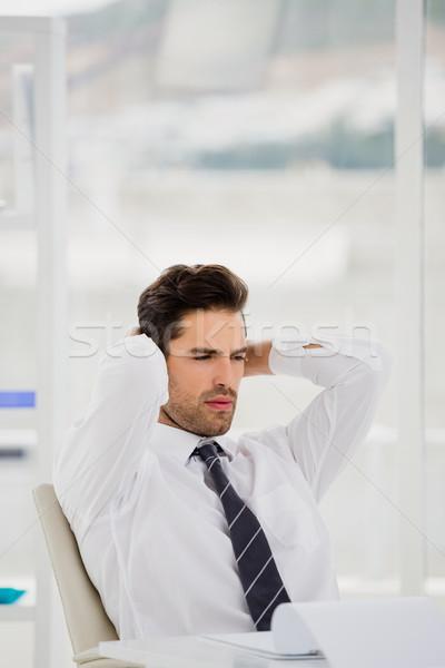 ストックフォト: ビジネスマン · ラップトップを使用して · メモを取る · オフィス · 紙 · 男