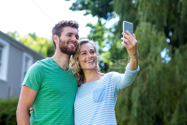 Gelukkig paar telefoon man vrouwelijke Stockfoto © wavebreak_media
