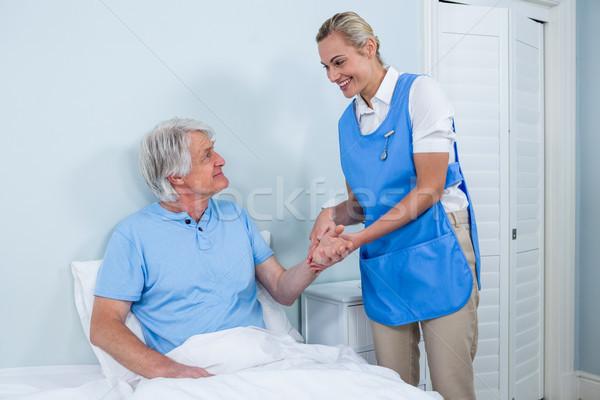 Nurse holding senior man hand in hospital Stock photo © wavebreak_media