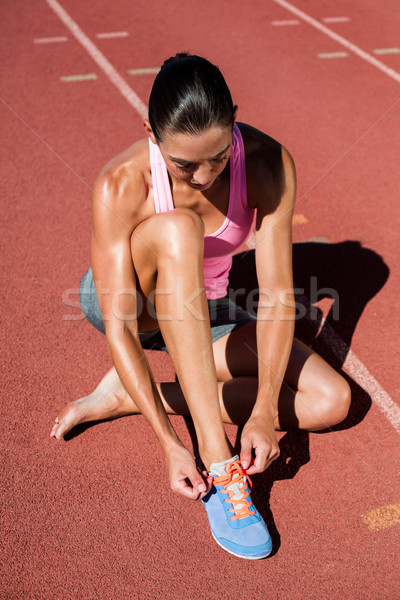 Vrouwelijke atleet loopschoenen lopen track vrouw Stockfoto © wavebreak_media