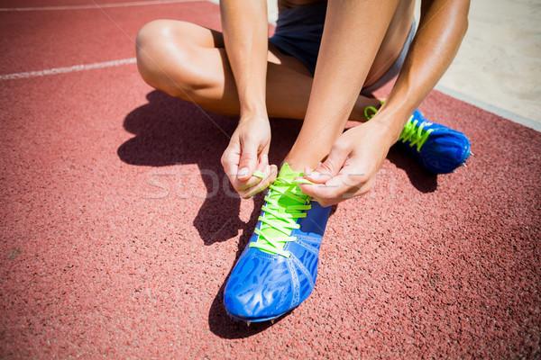Feminino atleta tênis de corrida corrida seguir mulher Foto stock © wavebreak_media