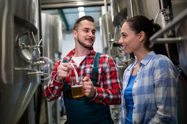 Brewers testing beer with litmus paper Stock photo © wavebreak_media