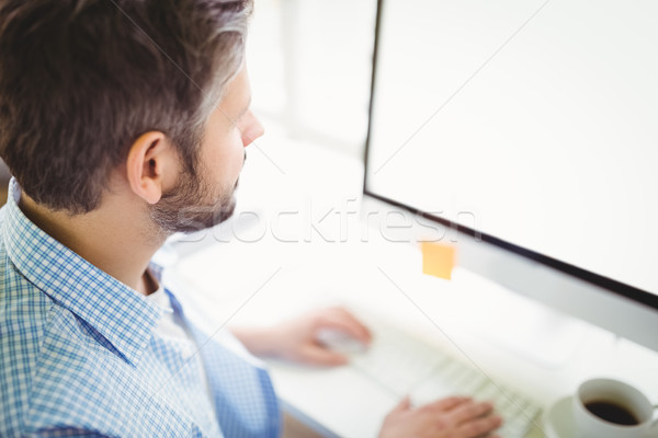 High angle view of businessman working in office Stock photo © wavebreak_media