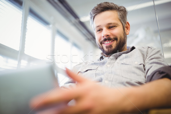 Low angle view of businessman working on laptop in office Stock photo © wavebreak_media