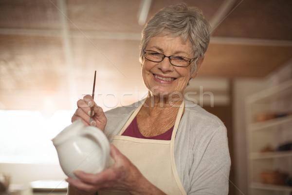 Femenino pintura jarra retrato cerámica taller Foto stock © wavebreak_media