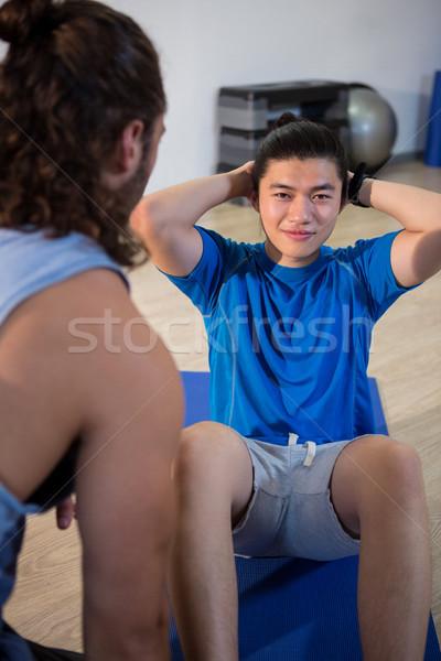 Fitness hombre hablar instructor gimnasio mujer Foto stock © wavebreak_media
