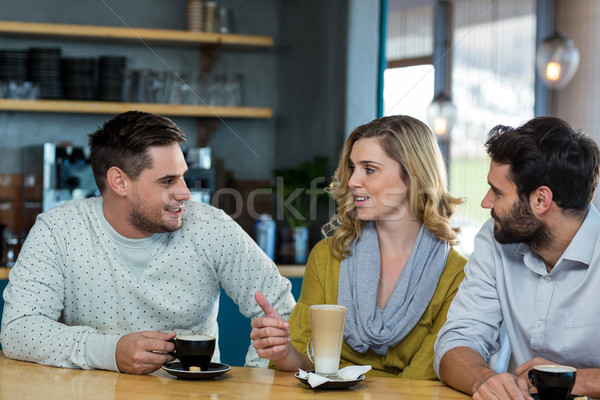 Friends interacting while have a cup of coffee Stock photo © wavebreak_media