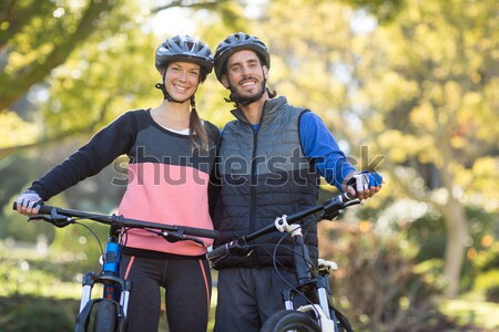 Biker couple giving high five to each other in countryside Stock photo © wavebreak_media