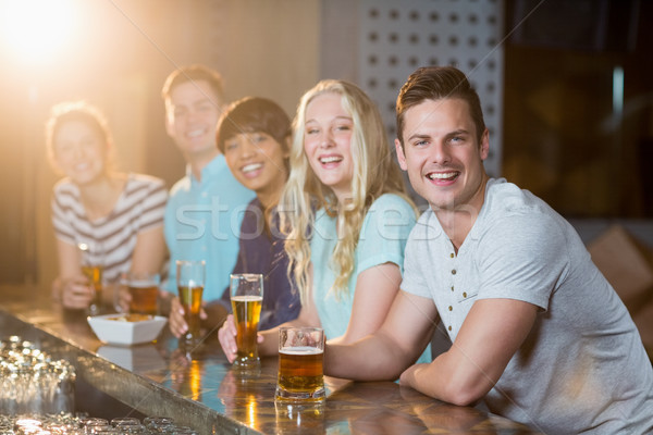 Group of friends having glass of beer at bar counter Stock photo © wavebreak_media