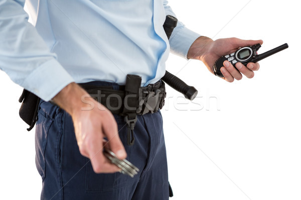 Mid section of security officer holding a walkie-talkie Stock photo © wavebreak_media