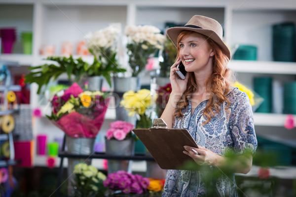 Female florist taking order on mobile phone Stock photo © wavebreak_media