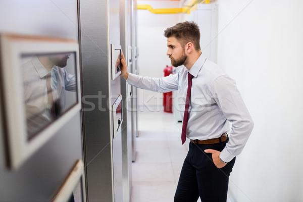 Technician looking at server cabinet Stock photo © wavebreak_media