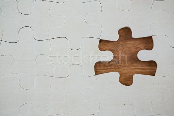 Jigsaw puzzle with one piece separately Stock photo © wavebreak_media