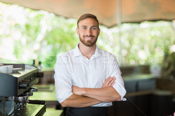 Waiter standing with arms crossed at restaurant Stock photo © wavebreak_media