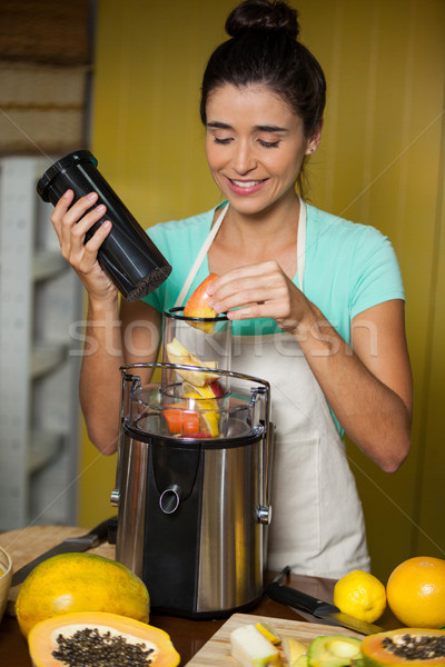 Smiling shop assistant preparing juice Stock photo © wavebreak_media