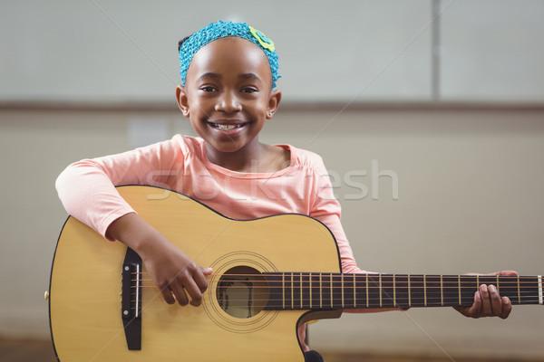 Sorridente jogar guitarra sala de aula escolas feliz Foto stock © wavebreak_media