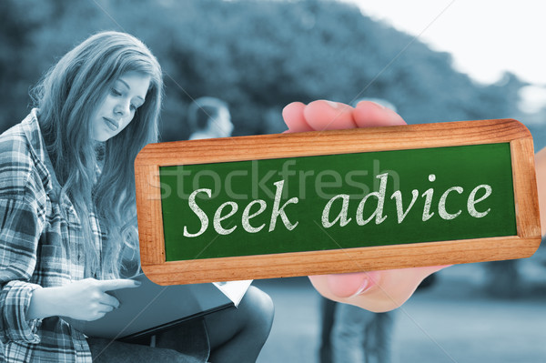 Seek advice against pretty student studying outside on campus Stock photo © wavebreak_media