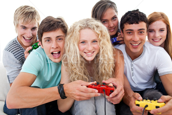 Portrait of teenagers playing video games in the living-room Stock photo © wavebreak_media