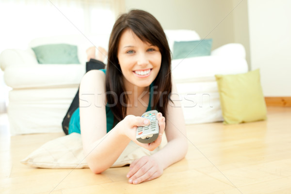 Morena mulher sala de estar televisão tecnologia Foto stock © wavebreak_media
