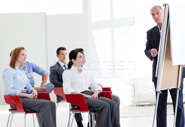 Stock photo: Multi-ethnic business people at a seminar