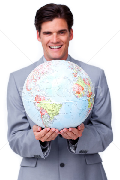Charismatic businessman holding a terrestrial globe  Stock photo © wavebreak_media