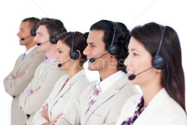 Confident business team lining up with headset on Stock photo © wavebreak_media