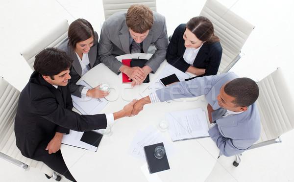 Di successo business internazionale persone stringe la mano ufficio mano Foto d'archivio © wavebreak_media