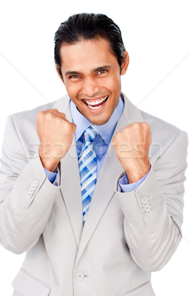 Attractive businessman punching the air celebrating a victory Stock photo © wavebreak_media
